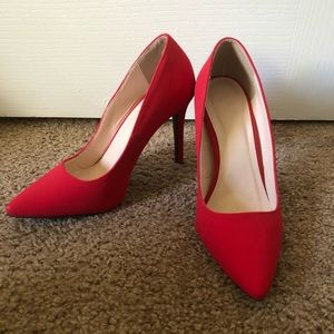 Red three inch pumps